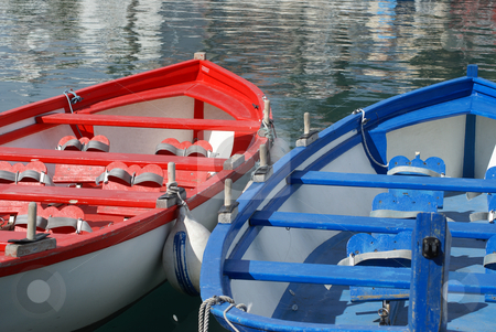 Red and blue boats stock photo, Traditional mediterranean  boats at anchor..French Riviera - Harbor of