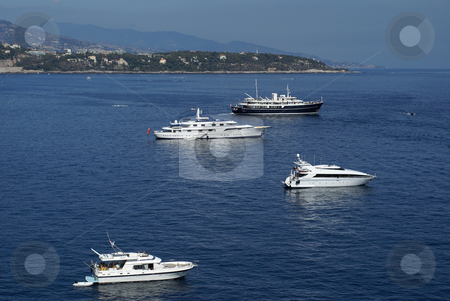 Monaco harbor stock photo, Luxuous motor boat anchored in Monaco's Bay. by Serge VILLA