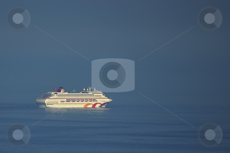 Lost in the sea stock photo, Crusing between sky and sea by Serge VILLA
