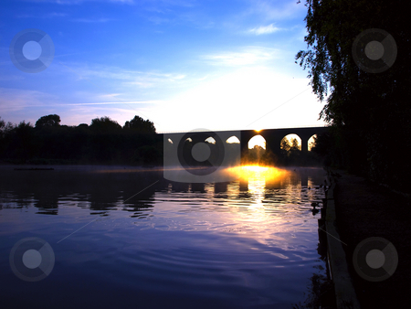 Viaduct Bridge over Misty Lake at Dawn Sunset stock photo, Viaduct Bridge over Misty Lake at Dawn Sunset by Robert Davies