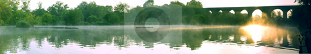 Panoramic Misty Lake Pond With Trees and Brick Viaduct stock photo, Panoramic Misty Lake Pond With Trees and Brick Viaduct at Dawn in British Summer by Robert Davies