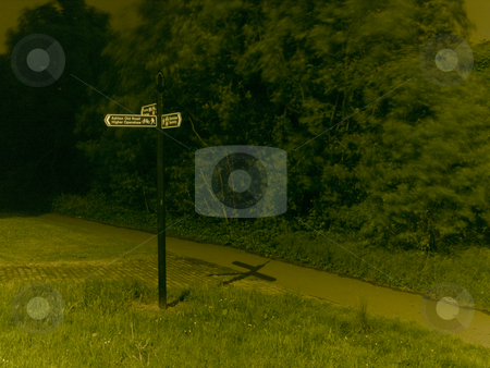 Road Sign in Park at Night for Directions stock photo, Road Sign in Park at Night for Directions by Robert Davies