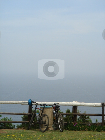 Bike rest stock photo, A single bike alone by a railing by a view by Johnny Griffin