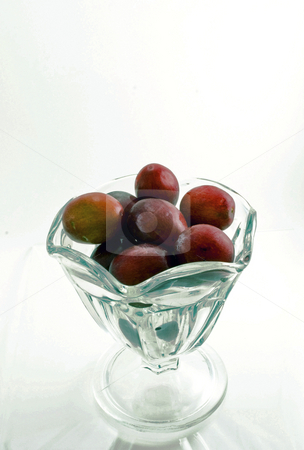 Cup of Grapes stock photo, Glass cup full of red grapes by Robert Cabrera