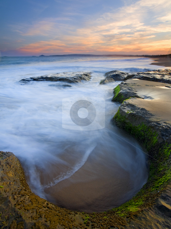 Tidal Bowl stock photo, A bowl like depression in a stone shelf catches the incoming tide as the sun sets over Encounter Bay, South Australia. by Mike Dawson