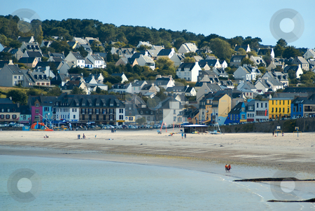 Brittany Colors stock photo, Sand Beach against a small Brittany village with colored houses by Serge VILLA