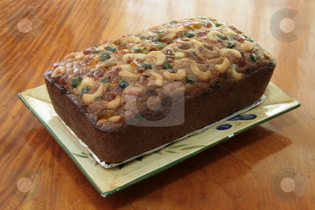 Banana bread stock photo, Banana bread loaf topped with glazed fruit and nuts by Jonas Marcos San Luis