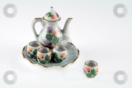 Teapot set stock photo, Miniature teapot with four cups and a tray by Jonas Marcos San Luis