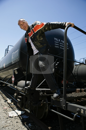Man holding train stock photo, Male fashion model  posing on train by Csaba Fikker
