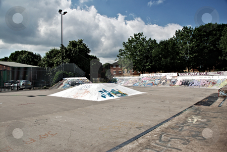 Skate Park Ramps stock photo, A photograph of a skate boarding park with ramps and graffiti by Philippa Willitts