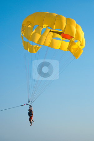 Parasailing stock photo, A motorboat with parachute prepared for parasailing by Serge VILLA