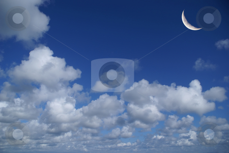 Moon stock photo, Cloudy blue sky with the moon crescent by Serge VILLA
