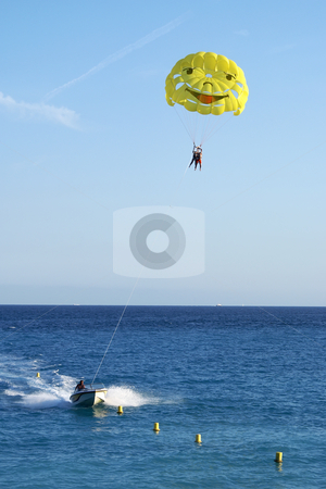 Parachute stock photo, Motor boat and parachute. Beach sport by Serge VILLA