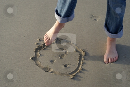 Drawing stock photo, Woman foot drawing a smiling face on the ocean beach at sunset by Serge VILLA