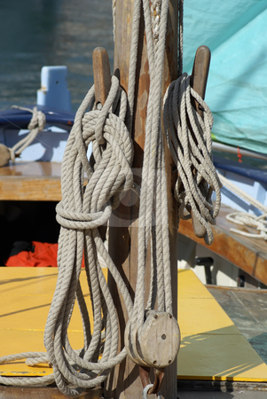 Mast and Rope stock photo, Close-up of wooden tools and ropes of a boat by Serge VILLA
