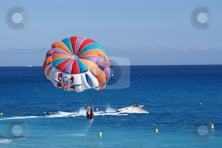Parachute stock photo, A motorboat with parachute prepared for parasailing by Serge VILLA