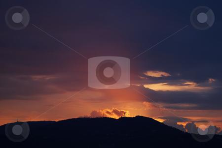 Rays of Sun stock photo, Photo of sun shine through rain cloud. by Serge VILLA