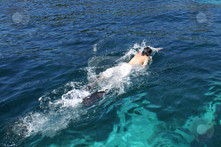 Diving in Mediterranean sea... stock photo, Young adult swimming near the coast of St Honora Island (French Riviera) by Serge VILLA