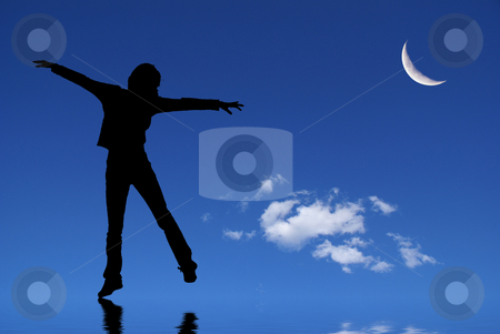 Dancing silhouette stock photo, Woman silhouette dancing on a mirror with a crescent moon in the backgroun by Serge VILLA