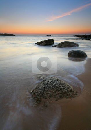 Stepping Stones stock photo, Twilight glows over the rocky beach at Horseshoe Bay, South Australia by Mike Dawson
