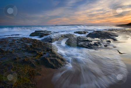 Covering the Beach stock photo, The waves of the incoming tide pounding the beaches of Encounter bay near Victor Harbor, South Australia by Mike Dawson