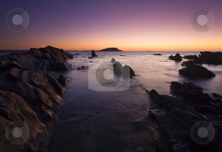The Teeth of Twilight stock photo, Twilight glows on the horizon revealing the jagged rocks at low tide in Encounter Bay near Victor Harbor, Australia by Mike Dawson