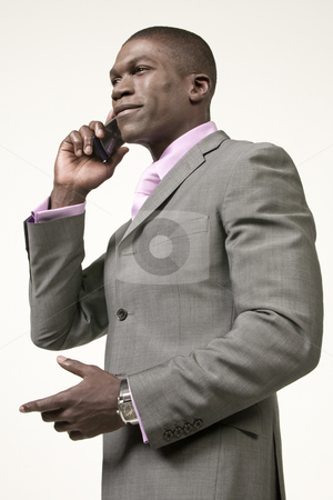 Black Businessman on the phone stock photo, Black Businessman talking on the phone by Csaba Fikker