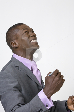 African American Professional celebrating stock photo, Black Businessman celebrating and looking to the heavans by Csaba Fikker