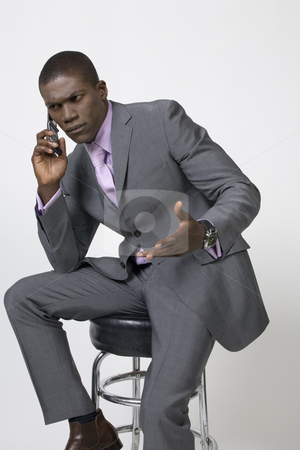 Black Businessman on the phone stock photo, Black Business man by Csaba Fikker