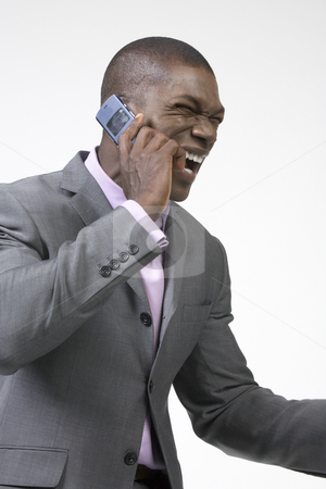 African American Businessman laughing stock photo, Black Businessman laughing on the phone by Csaba Fikker