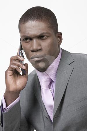 Black Businessman looking worried stock photo, Black Businessman looking worried on the phone by Csaba Fikker