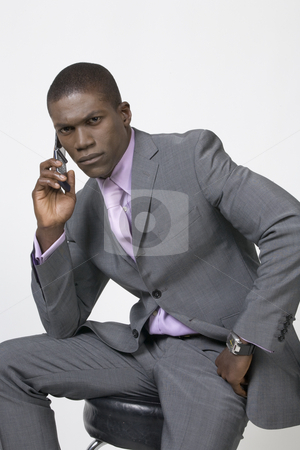 Black Businessman on the phone stock photo, Black Business man on the phone by Csaba Fikker