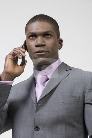 Black Businessman on the phone stock photo, Black Business man by Csaba Fikker