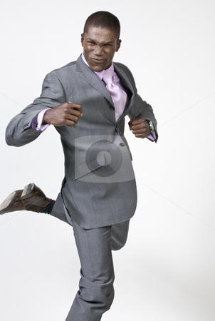 Black Businessman dancing stock photo, Black Businessman celebrating by Csaba Fikker