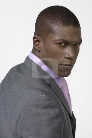 Black Businessman stock photo, Black Business man looking over his shoulder by Csaba Fikker