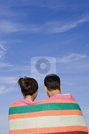 Couple wrapped in blanket stock photo, Couple wrapped in blanket by Mpixis World