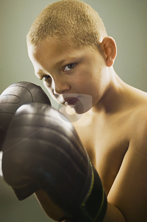 MPIXIS900788 stock photo, Boy wearing boxing gloves by Mpixis World