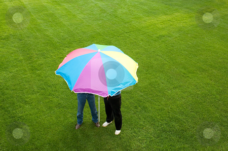 People under a parasol stock photo, People under a parasol by Mpixis World