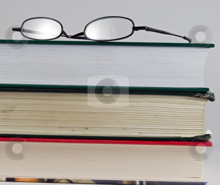 Knowledge is power stock photo, Books stacked on top of each other with glasses by Robert Cabrera