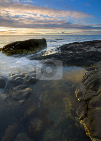 Freycinet Sunrise stock photo, Sunrise over the Freycinet Peninsula in the distance and a tidepool in the foreground by Mike Dawson