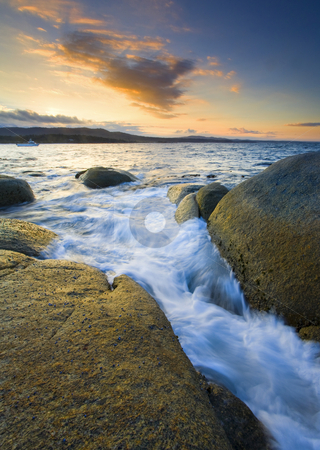 Finding the Seams stock photo, The incomiing tide finding the cracks and seams in the granite boulders of Binalong Bay on the Eastern Shore of Tasmania by Mike Dawson