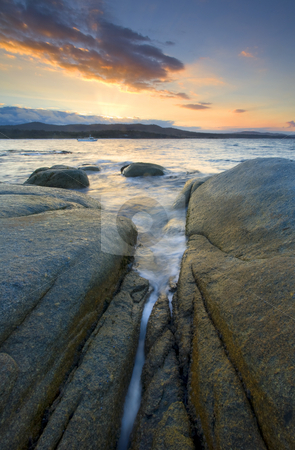 Filling the Cracks stock photo, The incoming tide fills the crakcs between granite boulders at Binalong Bay, Tasmania. by Mike Dawson