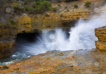 Tidal Explosion stock photo, A blowhole on the Tasman Peninsula erupting as the tides comes through as cave carved thorugh the limestone. by Mike Dawson