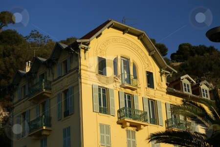 Yellow apartment building stock photo, Typical building in the city of Nice (French Riviera) by Serge VILLA