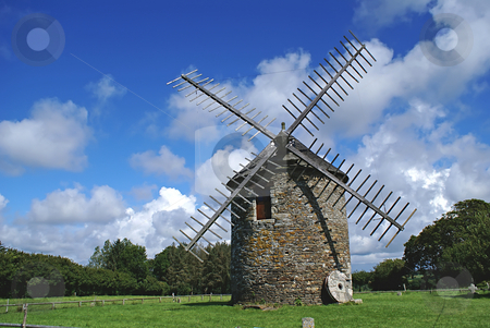 Windmill  stock photo, Windmill in a green field in Britany (France) by Serge VILLA