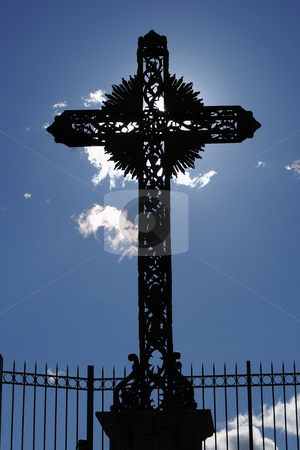 Faith stock photo, Dramatic sunlight behind a cruz in a small village of Provence (French Riviera) by Serge VILLA