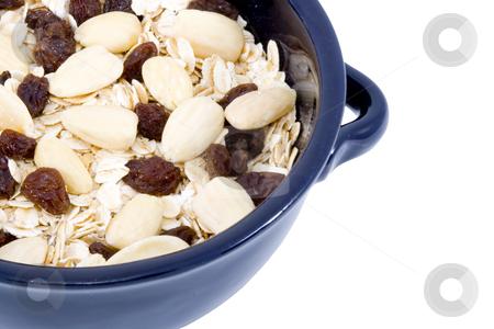Bowl of Oatmeal stock photo, A bowl of oatmeal with raisins and almonds - healthy diet by Petr Koudelka