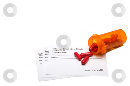 Prescription Medication stock photo, A medical prescription pad and prescribed pills. by Robert Byron
