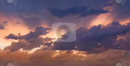 Divine Light stock photo, Heavenly light streaming from behind storm clouds on a warm summer night by Mike Dawson