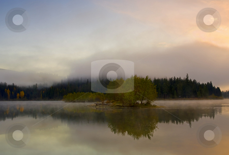Island in the Fog stock photo, Morning mist rising around a small island in Clear Lake as the sun rises by Mike Dawson